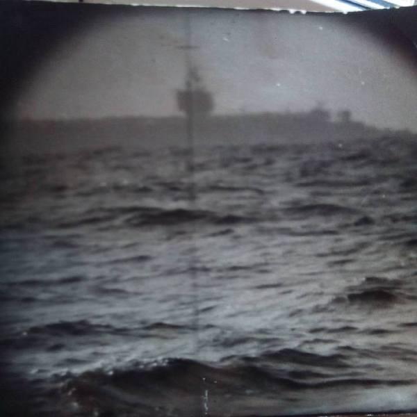Америкаский авианосец в объективе советской подводной лодки.