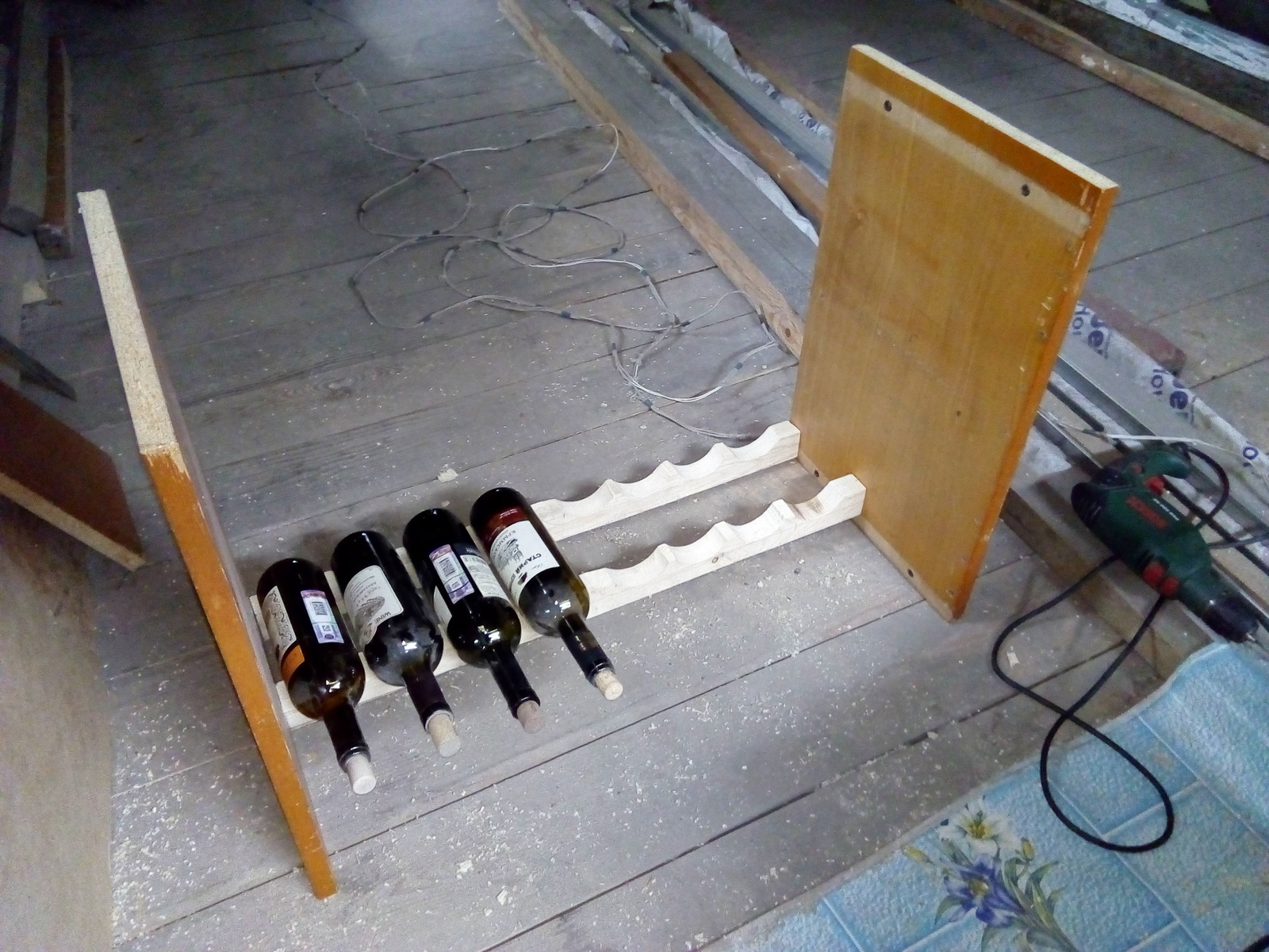 A bookcase for wine bottles, planks, bottles, you can see, approximately, made, full, larger, front, shelves, cupboard, wall, Bars, it will be aesthetics, rail, shelf, marked, only made